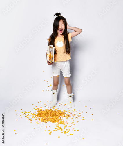 Yawing asian girl kid failed with making breakfast at the morning Tablou Canvas