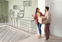 Happy Couple Imagining Interior Of New House On Moving Day
