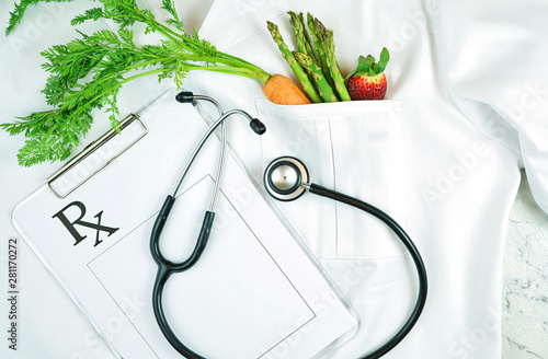 Healthy lifestyle, food is medicine, concept flatlay with fruit and vegetables in pocket of white doctor's coat with clipboard and stethoscope Fototapet