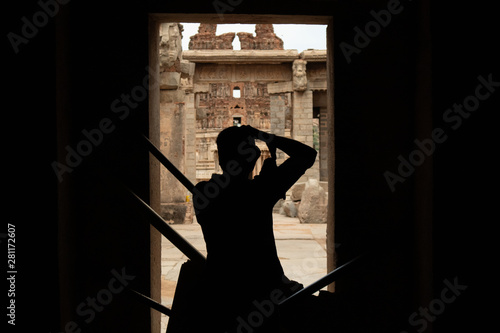 Hampi, India July 9, 2019 : Photographer capturing the photo of ruined Vittala T Canvas Print