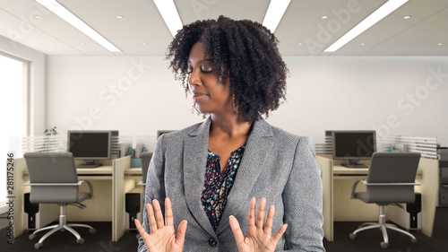 Fotografiet  Black African American businesswoman in an office looking disgusted