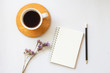 Flat lay of coffee with notebook and copy space on white background.