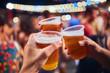 canvas print picture - Friends drinking beer at night with de-focused lights in the background. Shallow focus.