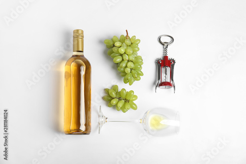 Fototapeta Composition with wine and grape on white background, top view obraz