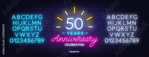 Cuadros en Lienzo Fifty years anniversary celebration neon sign on a dark background