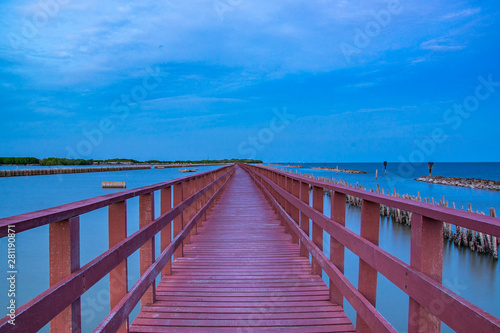 Foto auf AluDibond Hochrote Beautiful of The walkway red wooden bridge in evening at Bang Khun Thian sea view, Bang Khun Thian, Bangkok.