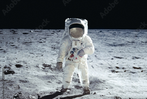 Fototapeta The astronaut goes across the Moon, in a white space suit Elements of this image
