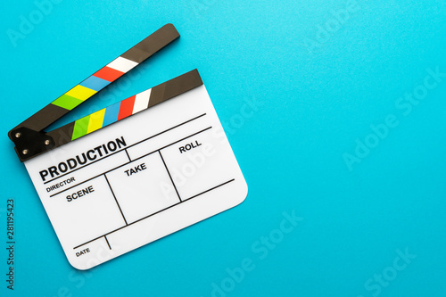 Fotografija Top view photo of open white clapperboard over turquoise blue background with copy space