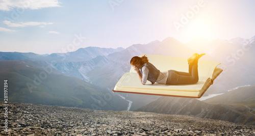 Little woman with large book concept Obraz na płótnie