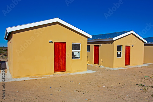 Cuadros en Lienzo Two recently built low-cost RDP homes