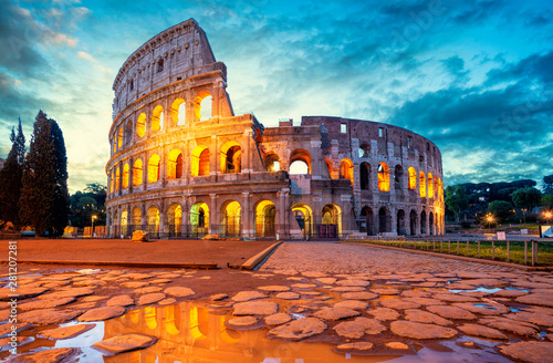 Poster Con. Antique Colosseum morning in Rome, Italy. Colosseum is one of the main attractions of Rome. Coliseum is reflected in puddle. Rome architecture and landmark.