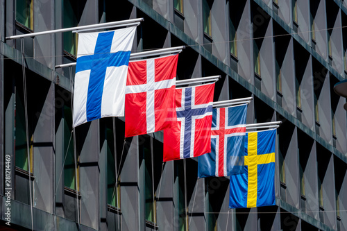Obraz Five Nordic flags on flagpoles with EU flag. Denmark, Sweden, Norway, Finland, Iceland - fototapety do salonu