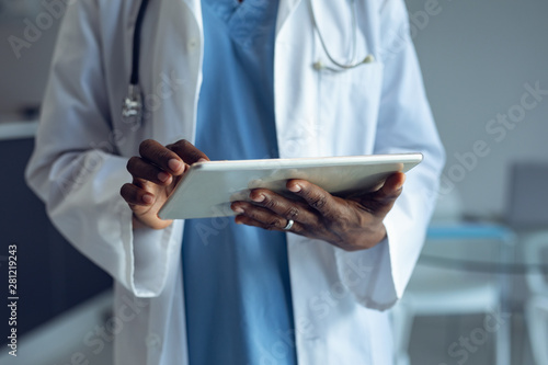 Male doctor using digital tablet in hospital