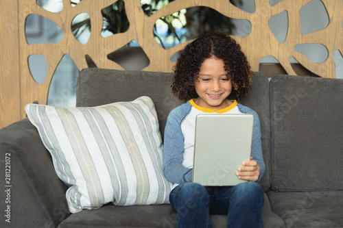 Boy using digital tablet in the lobby at hospital