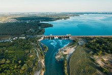 Dam At Reservoir With Flowing Water, Hydroelectricity Power Station, Aerial Panoramic View