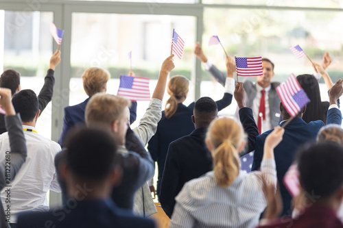 Businessman doing speech and celebrating victory in conference room