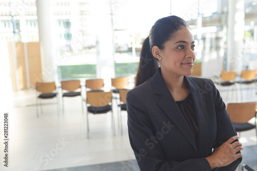 Attentive businesswoman standing in conference room