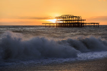Landscape Of Old Pier At Sunset With Waves La Manche Brighton, Sussex, South Of England