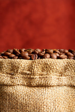 Coffee Beans In The Bag Close-up. Copy Space.