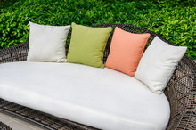 Pillows On Mattress And Weave Wooden Sofa