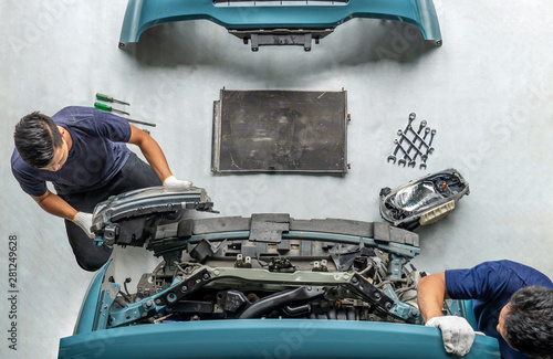 Fotografie, Obraz  Two repairman mechanics ,Check for damaged cars at the repair station, Maintenan
