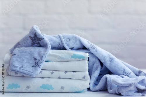set for a boy, muslin diaper, fleece pajamas, background. Fototapet