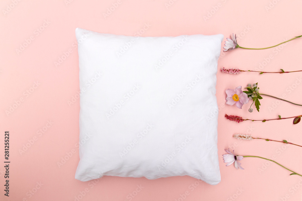 Fototapety, obrazy: Blank white cushion mock up on pink background with wild flowers right and space left - empty and ready to add your own design