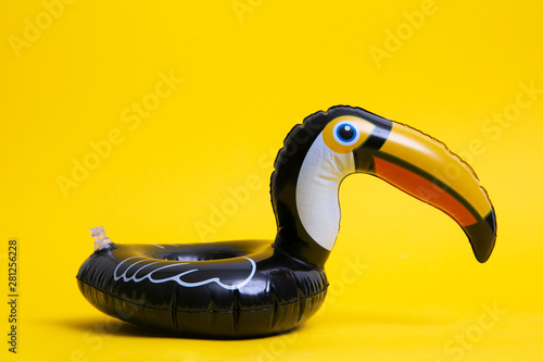 Slika na platnu Pelican summer inflatable holiday pool toy against a bright yellow background