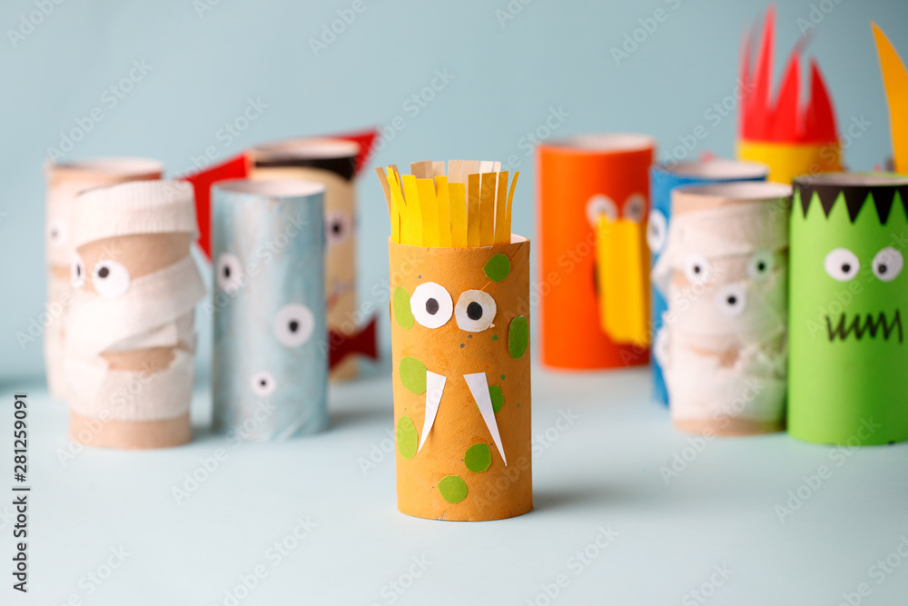 Fototapeta Decoration for Halloween home party - monsters made with toilet paper roll. Handicraft Monsters, concept of eco-friendly reuse recycle diy creative idea