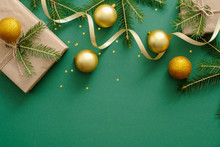 Christmas Flatlay Composition With Christmas Balls, Presents, Fir Tree Branches, Decoration On Green Background. Flat Lay, Top View, Overhead. Xmas Or New Year Concept. Banner Template With Copy Space