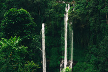 Sekumpul Waterfall In Bali Surrounded By Tropical Forest