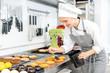Leinwanddruck Bild - Pastry chef glazing little cakes
