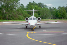 Small Jet Airplane Parked On T...