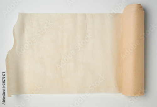 light brown roll with parchment paper spun on a white background Canvas-taulu