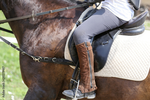Closeup of a leather saddle for equestrian sport on horseback Canvas Print