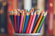 canvas print picture - Colorful colored pencils on blurred bokeh background