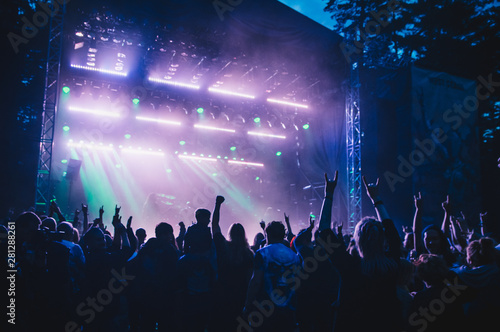 Crowd with raised hands in concert - 281288261