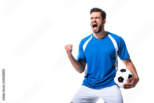 Tablou Canvas excited soccer player with ball and clenched hand Isolated On White