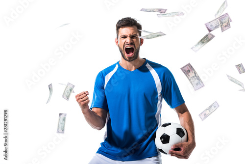 Wallpaper Mural soccer player with ball cheering with clenched hand near falling money Isolated