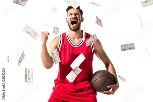 Fototapeta yelling basketball player Isolated On White with falling money