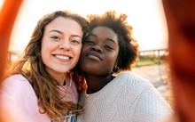Portrait Of Smiling Friends Outdoors