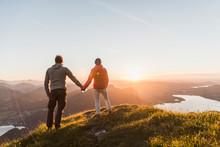 Austria, Salzkammergut, Couple Standing On Mountain Summit, Enjoying The View