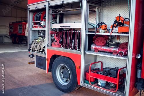 Fire engine with equipment in the fire department and ready for challenge Fototapet