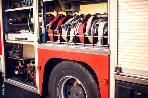 Canvastavla Fire engine with equipment in the fire department and ready for challenge