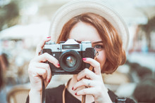 Closeup Portrait Of A Young Hipster Woman With Retro Camera Outdoors