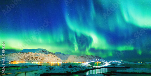 Tuinposter Noorderlicht Amazing view on natural wonder Northern Lights or Aurora Borealis over lighting Kubholmenleia bridge crossing the fjord. Lofoten Islands Archipelago in Norway, location over Polar Circle.