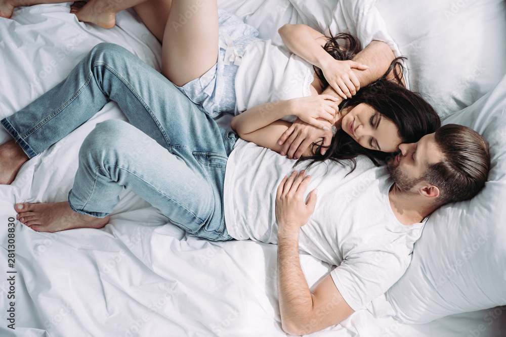 Fototapety, obrazy: top view of attractive woman and man with closed eyes hugging and sleeping