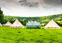 An Iconic Camper Van At A Glamping Site In The English Countryside