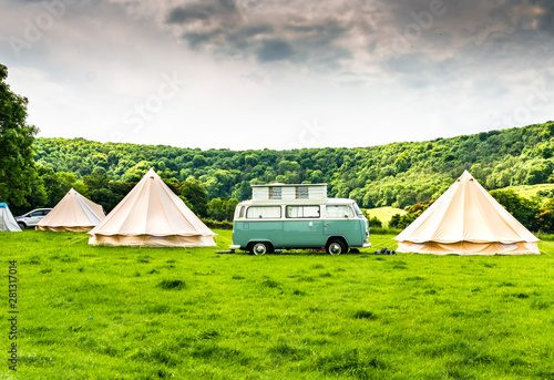 An iconic camper van at a glamping site in the English countryside Canvas Print