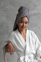 Portrait Of Woman With Towel On Her Head